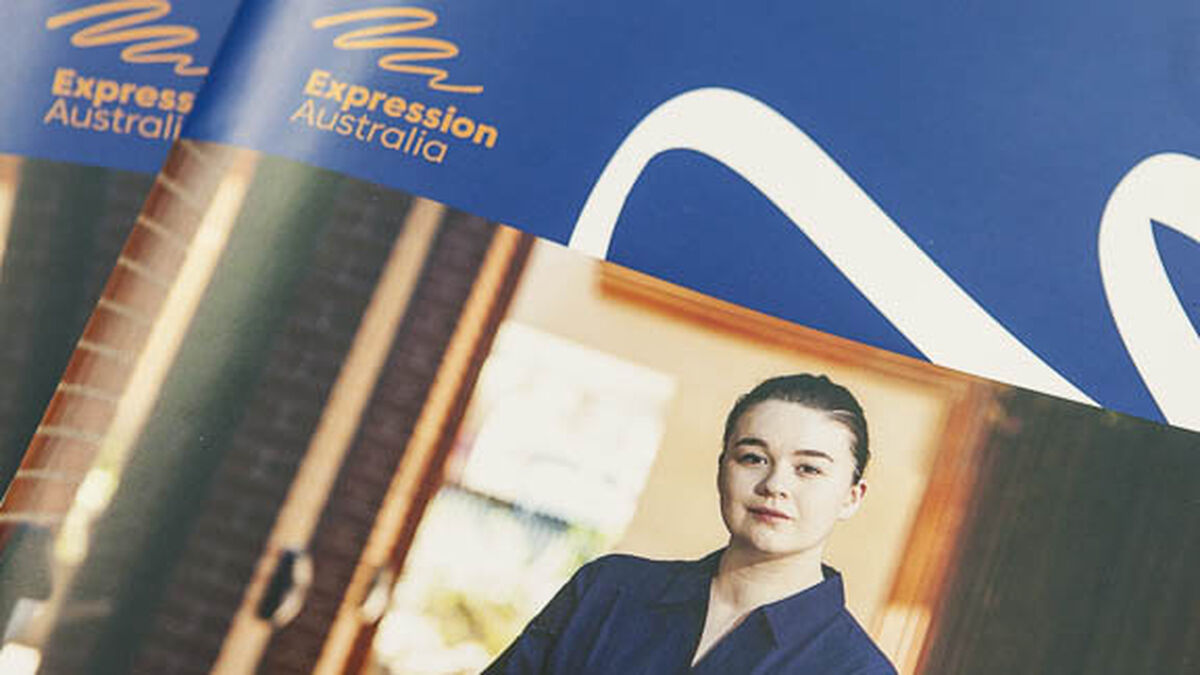 A section of the cover of Expression Australia's 2017-18 Annual Report. It shows the Expression Australia logo and a photo of a purposeful young woman.